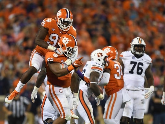 Clemson defensive lineman Clelin Ferrell (99) celebrates with defensive lineman Christian Wilkins (42) after a defensive stop against Auburn during the 3rd quarter on Saturday, September 9, 2017 at Clemson's Memorial Stadium.