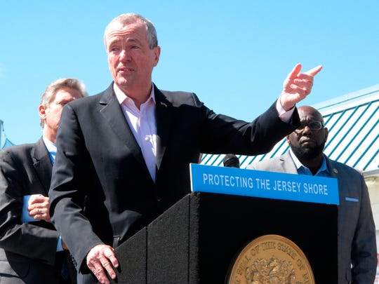 New Jersey Gov. Phil Murphy speaks at a press conference on the boardwalk in Point Pleasant Beach, N.J. on Friday April 20, 2018, before signing a bill banning offshore oil and gas drilling in New Jersey's state waters, as well as prohibiting infrastructure to support drilling in more distant federal waters. New Jersey is one of numerous coastal states using state bans to try to thwart President Trump's plan to open most of America's coastline up to drilling.