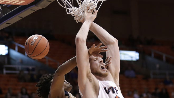 UTEP's Matt Willms is fouled from behind by FIU's Hassan Hussein as he goes for a dunk Thursday at the Don Haskins Center.