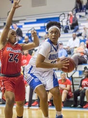Janelle Jones (10) drives to the basket against Aaliyah