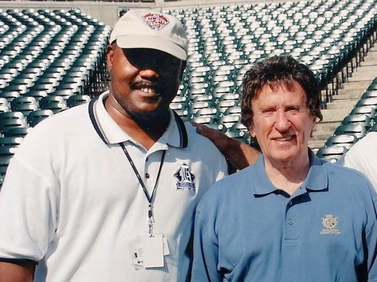 Cliff Russell is photographed with Detroit Tigers owner Mike Ilitch while at Comerica Park the summer of 2004. Russell was the first African American media relations spokesman in Major League Baseball thanks to the late owner who put an emphasis on diversity in his team's front office.