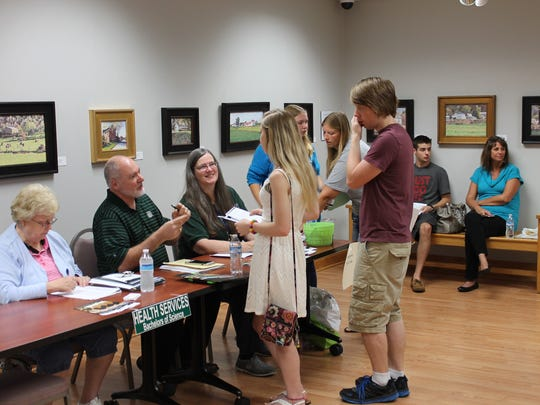Students chat with faculty at a recent orientation