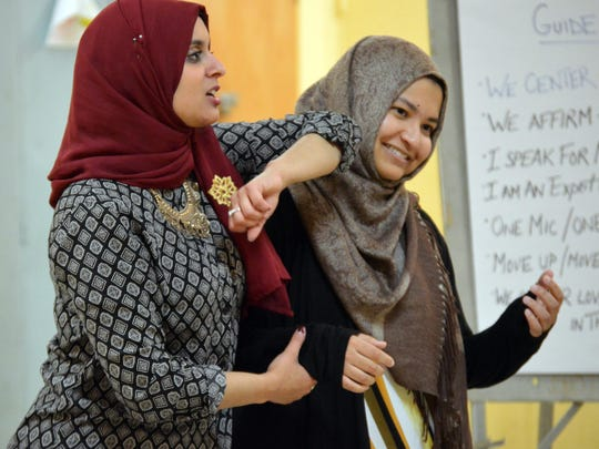 In this Dec. 18 photo, Rana Abdelhamid shows how to escape when an attacker grabs your arm during a self defense class in Washington.