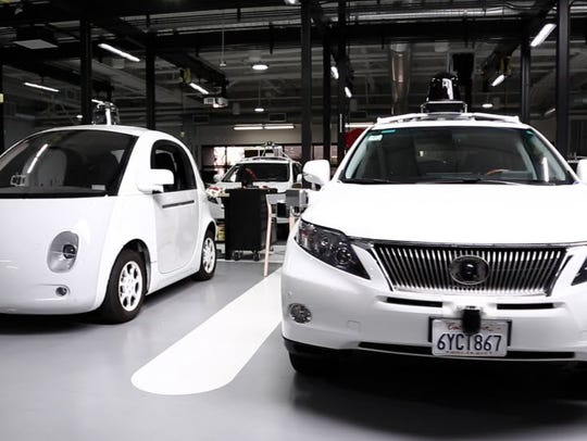 Inside Google's self-driving car lair are parked a
