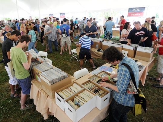 Music fans shop at  Dogfish Head's Analog-A-Go-Go festival at the company's Milton brewery in 2014.