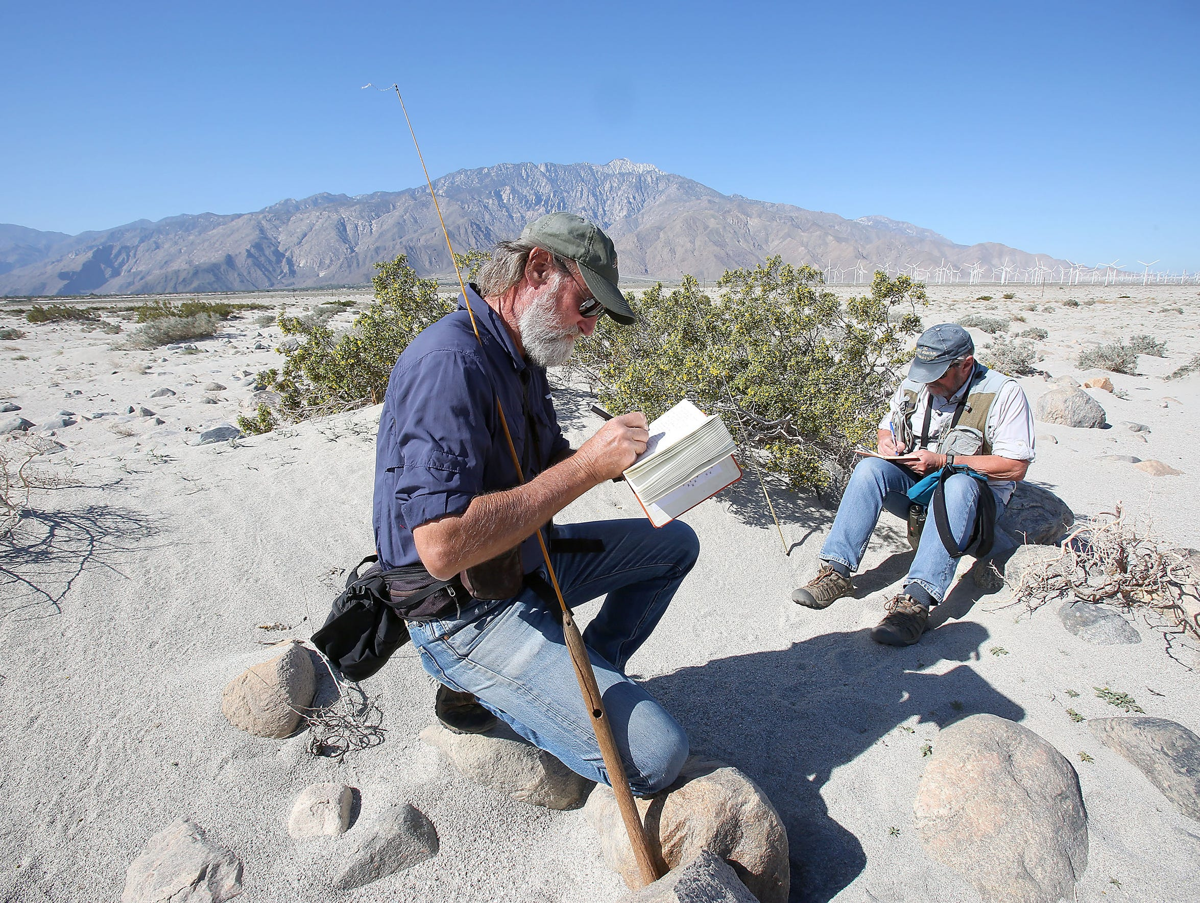 Mark Fisher, left, and Allan Muth take notes while