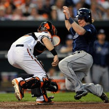 Rays catcher Ryan Hanigan  is out at home  as  Orioles catcher Caleb Joseph  applies the tag.