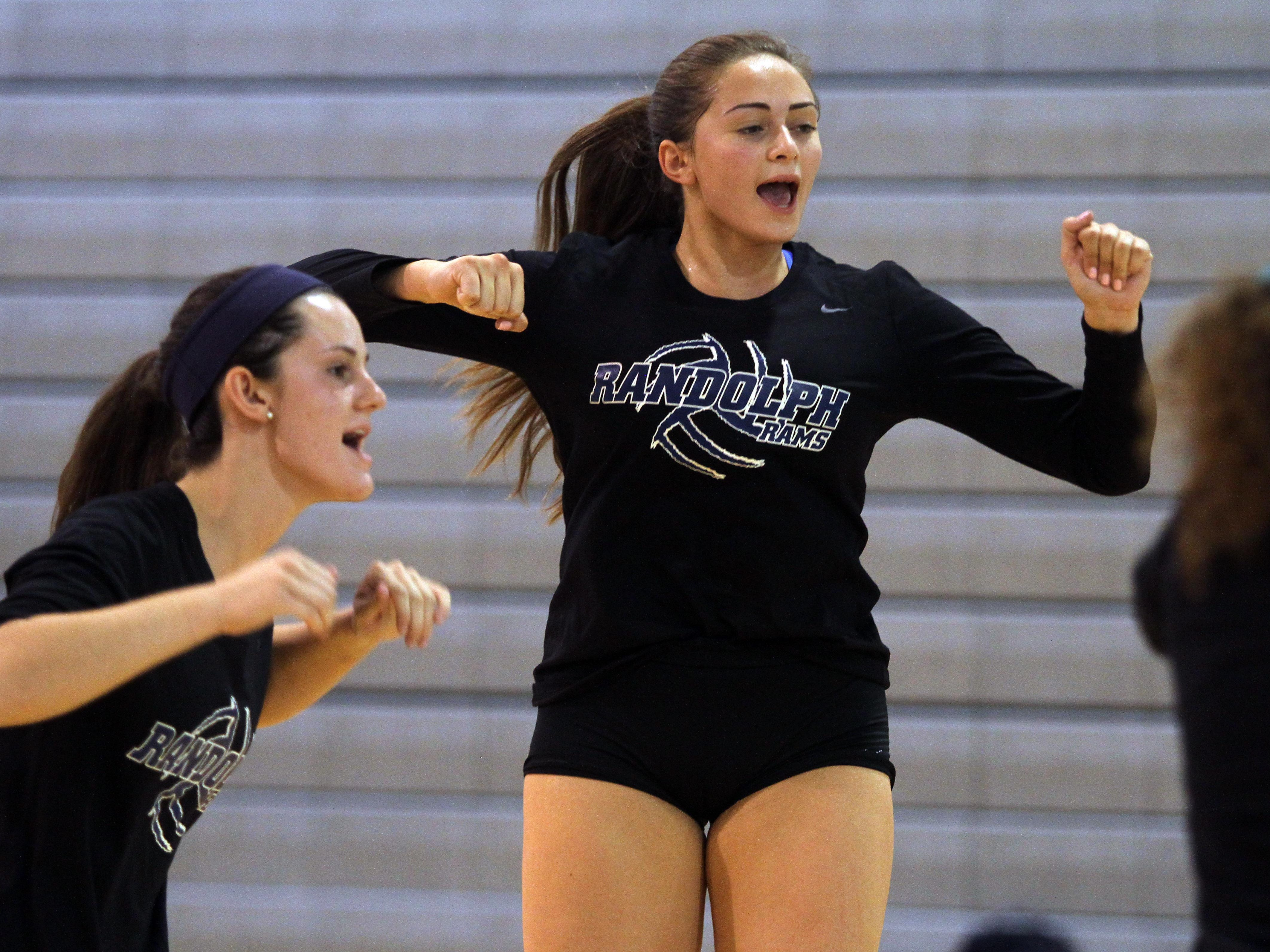 Randolph senior outside hitter Jenna Leanza, r, celebrates after a point.