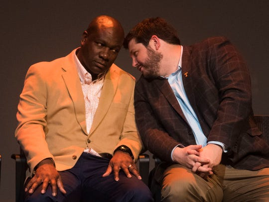 From left wide receiver coach David Johnson and tight ends coach Brian Niedermeyer whisper to each other during University of Tennessee's National Signing Day celebration at the Tennessee Theatre Wednesday, Feb. 7, 2018.