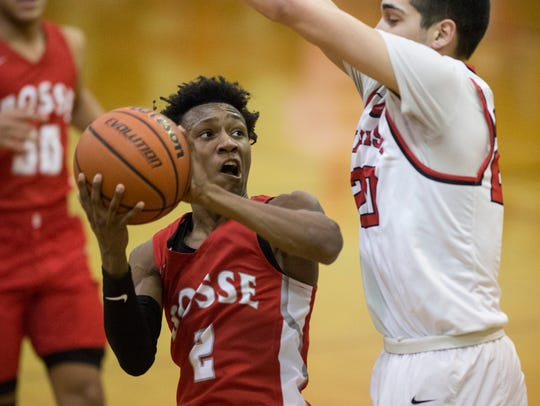 Bosse's Mekhi Lairy (2) goes up for a shot on Harrison's