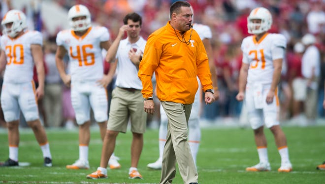 Tennessee Head Coach Butch Jones walks on the field before the Tennessee vs. Alabama game at Bryant-Denny Stadium in Tuscaloosa, Alabama Saturday, Oct. 21, 2017.