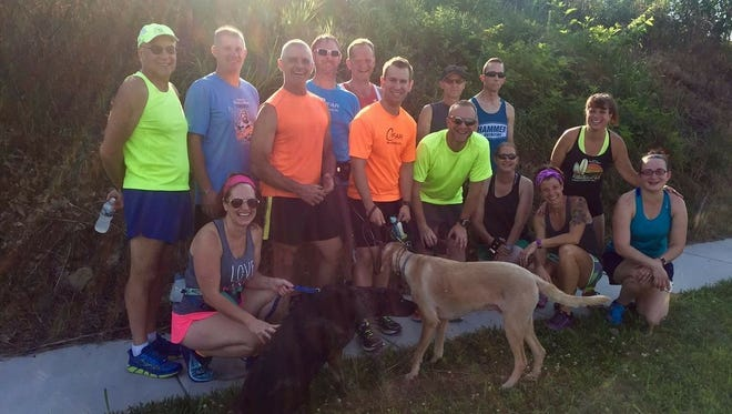 Locals pose for a photo after completing a group run in Waynesboro on July 18.