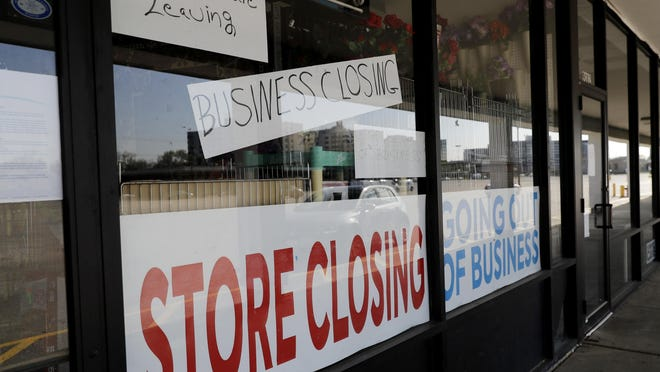 A sign announces a store closing in Niles, Ill., Wednesday, May 13.