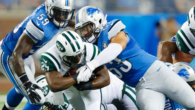 New York Jets running back Bilal Powell (29) is tackled by Detroit Lions outside linebacker Kyle Van Noy (53).