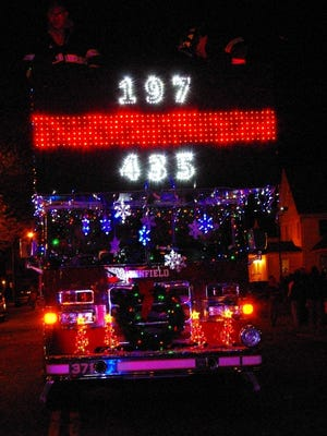 The Penfield Fire Department honored our fallen firefighters by emblazoning their uniform numbers on their truck during the Parade of Lights.
