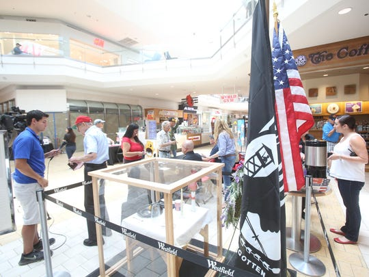 A memorial is set up during an event to honor soldiers at Westfield Mall in Palm Desert on July 3, 2015.