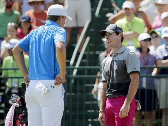 Rory McIlroy, right, of Northern Ireland talks to Jordan Spieth on the first tee during the first round of the PGA Championship on Thursday at Whistling Straits in Haven, Wis.