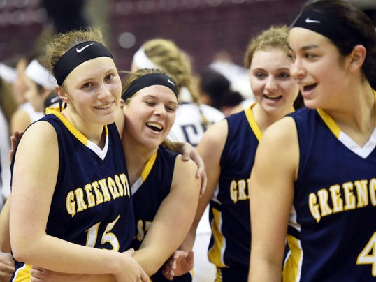 Greencastle-Antrim players celebrate after a 42-40 win against previously undefeated West York in a District 3 Class AAA girls basketball semifinal on Wednesday afternoon at Giant Center.