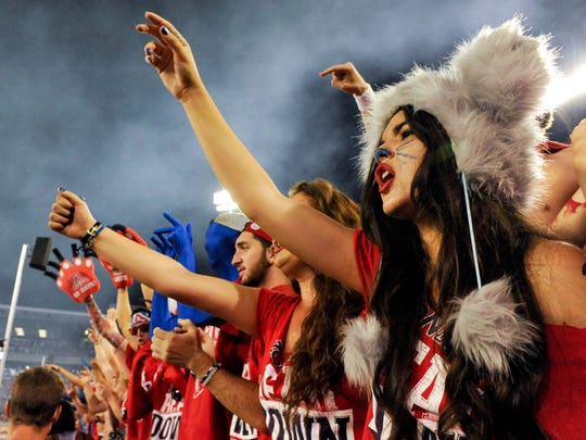 Fans in the Arizona Wildcats 'Zona Zoo' student section cheer as the Wildcats enter the field before the game against the UNLV Rebels on Aug. 29, 2014, at Arizona Stadium.