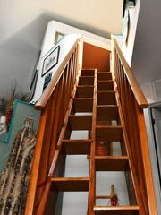The stairs to the second-floor master suite in this