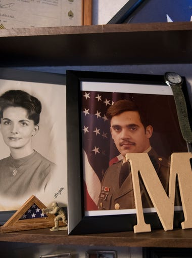 Leasher keeps a shelf of mementos that belonged to Mark Elkins on a shelf in his home in Chillicothe, Ohio.