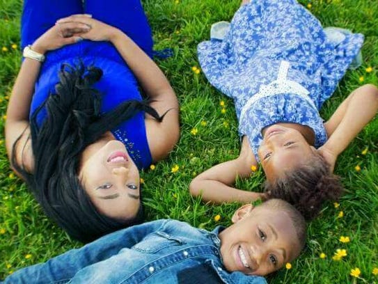Tieausha Thomas, left, with her children, son Tevin,