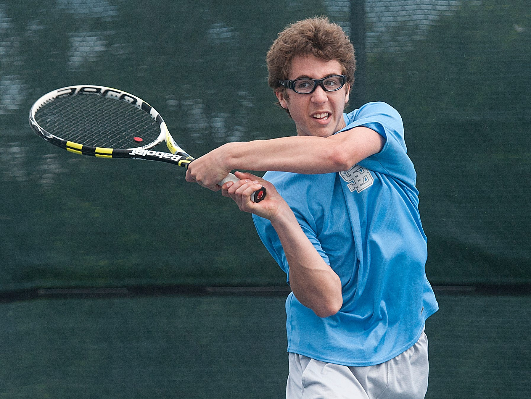 South Burlington's Marco Cepeda hits the ball against a serve by Stowe's Sam Salvas at the boys high school tennis championship last season.