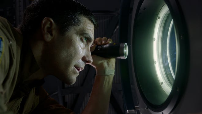 """Jake Gyllenhaal keeps a look out for the homicidal jellyfish alien in """"Life."""""""