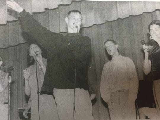Members of Grace Fellowship youth group performed during a flood benefit concert in April 1997.