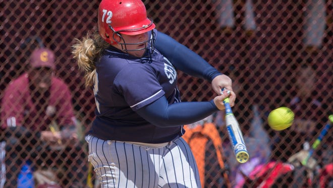 Mater Dei's Paige Fernandez drives in a run during Mater Dei vs Central Regional Softball in Regional Autism Challenge game.