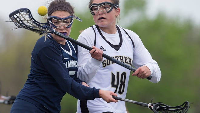 Toms River SouthÕs Nicole Andriani tries to scoop up a ball in the air as Toms River NorthÕs Ashley Rosal tries to crowd her. Southern Regional vs Toms River North Girls Lacrosse in Toms River, NJ on May 5, 2016