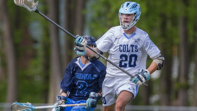 CBA's Jack Koury heads in toward the goal during first half action. Freehold Township Boys Lacrosse vs Christian Brothers Academy in Middletown, NJ on 5/9/17.