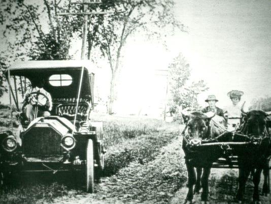 636361575758924705--1-310-25-Automobile-vs-oxen-Roland-Schomberg.jpg