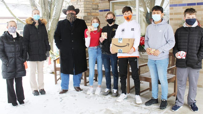 Carol Holmes and Jess Leathers,  directors of development at Thurston Woods Village in Sturgis, with Sturgis Middle School wood shop teacher Vince Royer and students Kylie Brooks, Quinn Goodman, Carson Eicher, Angel Alvarez and Austin Crites.