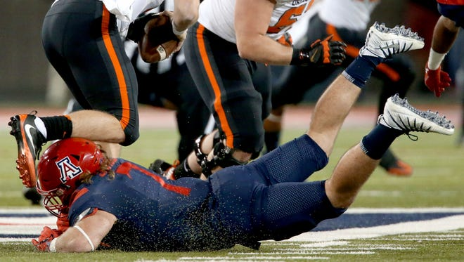 Arizona linebacker Colin Schooler (7) flies in and gets enough of Oregon State quarterback Darell Garretson (10) for a sack during the second quarter of an NCAA college football game Saturday, Nov. 11, 2017, Tucson, Ariz. (Kelly Presnell/Arizona Daily Star via AP)