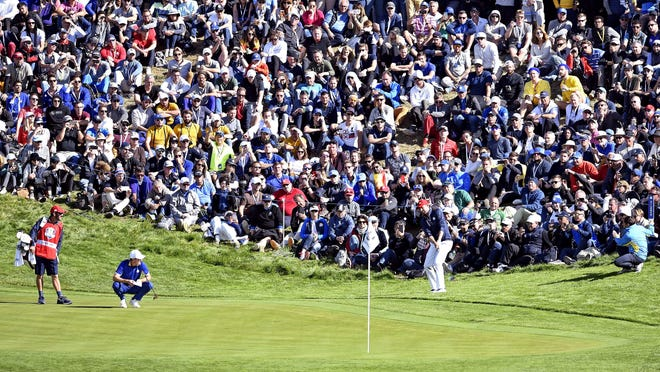 United States golfer Webb Simpson chips on the 11th hole in front of a massive crowd during the Sunday singles matches at Le Golf National Sep 30, 2018, in Paris, FRA.