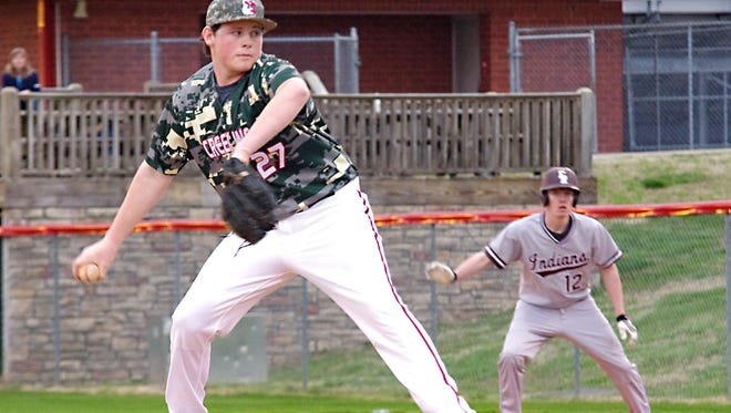Conner Pate looks to strike out another East Robertson batter during Thursday's Creek Wood home game.