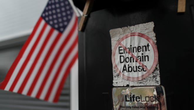 """An """"Eminent Domain Abuse"""" sticker on the mail box at Patricia Shipman's home in the Pleasant Ridge neighborhood of Charlestown, Indiana. Dec. 5, 2017"""