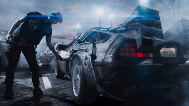 """Parzival (Tye Sheridan) hops into a DeLorean familiar to movie fans in """"Ready Player One."""""""