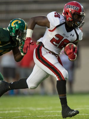 Opelika's Weldrin Ford (26) runs for a touchdown during the AHSAA football game Thursday, Sept. 1, 2016, at Cramton Bowl in Montgomery, Ala.