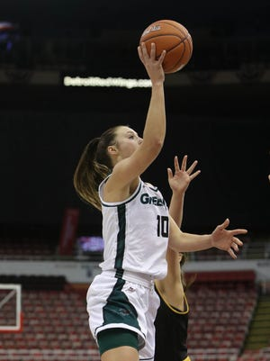 UWGB senior Mehryn Kraker drives against Milwaukee forward  Alexis Lindstrom during the second quarter of the Little Caesars Horizon League tournament on Monday, March 6, 2017 at Joe Louis Arena in Detroit Michigan.