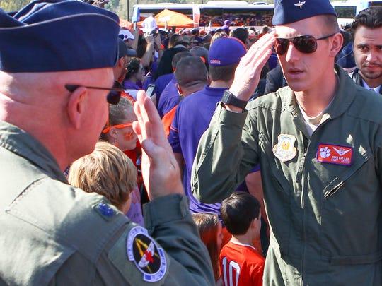 U.S. Air Force Lt. Col. Michael Mac Lain, left, salutes