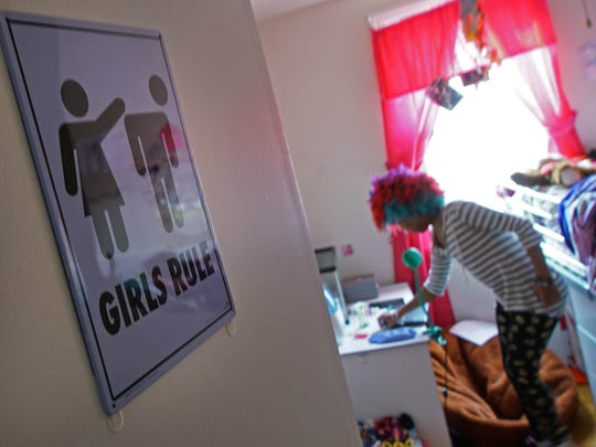 A Girls Rule sign decorates the doorway to 13-year-old Trinity Neal's bedroom.