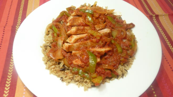 Pork Creole uses green peppers, onions and spices to evoke the flavor of Louisiana.