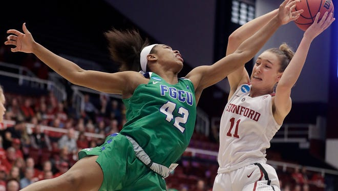 Stanford forward Alanna Smith (11) grabs a rebound against Florida Gulf Coast guard Tytionia Adderly (42) during the first half of a second-round game in the NCAA women's college basketball tournament in Stanford, Calif., Monday, March 19, 2018.