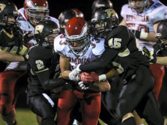 Bermudian Springs' Briton Shelton is sandwiched by Biglerville defenders Ben Hurda (2) and Colton Sentz (45) during the Eagles' 42-7 win in 2014. (Shane Dunlap -- GameTimePA.com)