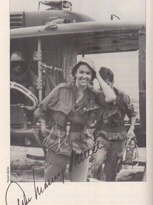 Anne Morrissy Merick as a correspondent in the Vietnam War.