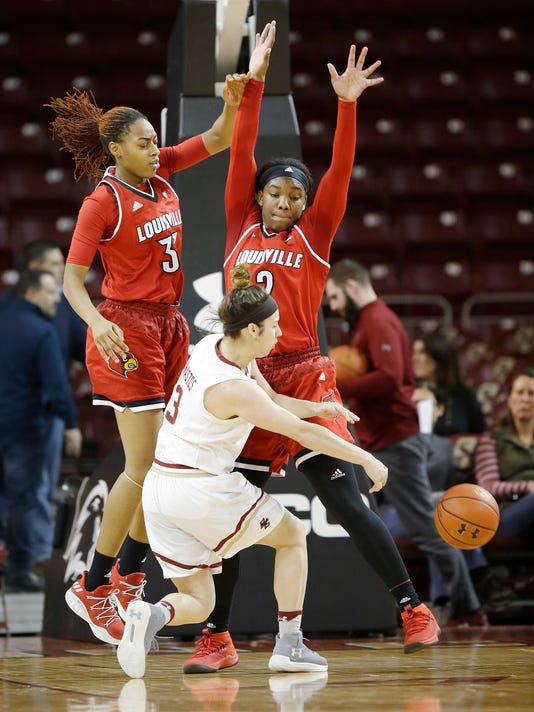 Boston College guard Andie Anastos (3) finds an outlet past the defense of Louisville forwards Bionca Dunham (33) and Myisha Hines-Allen (2) during the first half of their NCAA college basketball game Thursday, Feb. 15, 2018, in Boston. (AP Photo/Stephan Savoia)