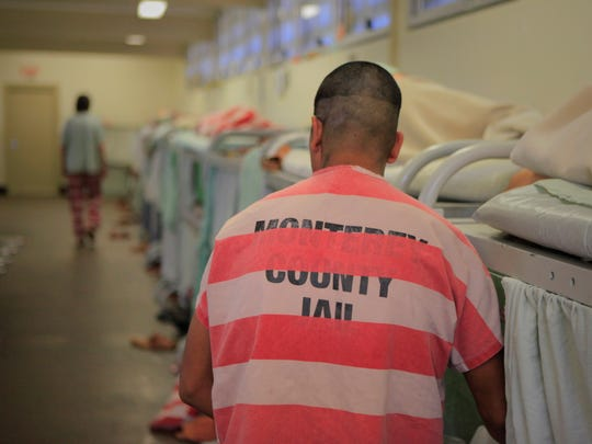 A prisoner stands by a bed at Monterey County Jail in this file photo.