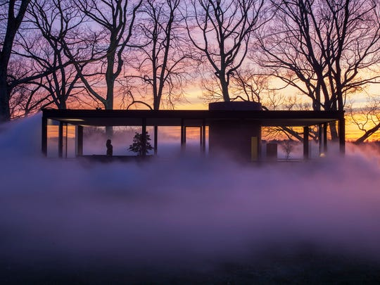 The fog installation, commissioned by the director of the Glass House, is designed to reflect and engage the aesthetic concepts central to the design of the iconic structure itself.